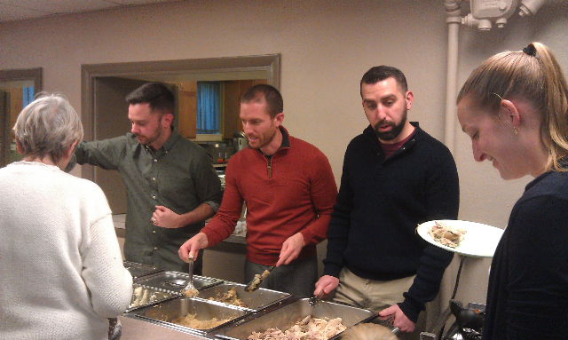Matt Adam and Matt serving food