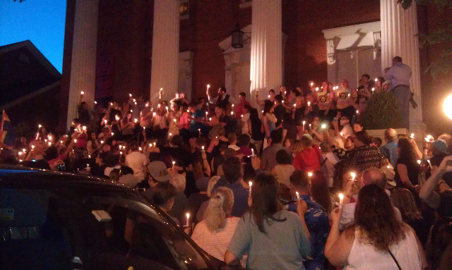 Crowd on steps with candles.jpg
