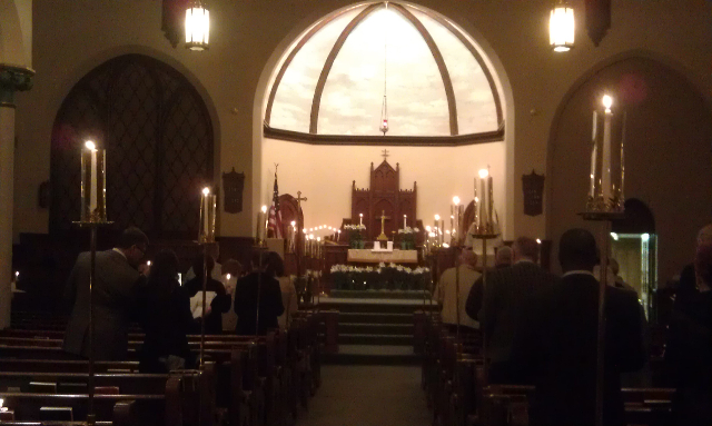 candlelight from the pews
